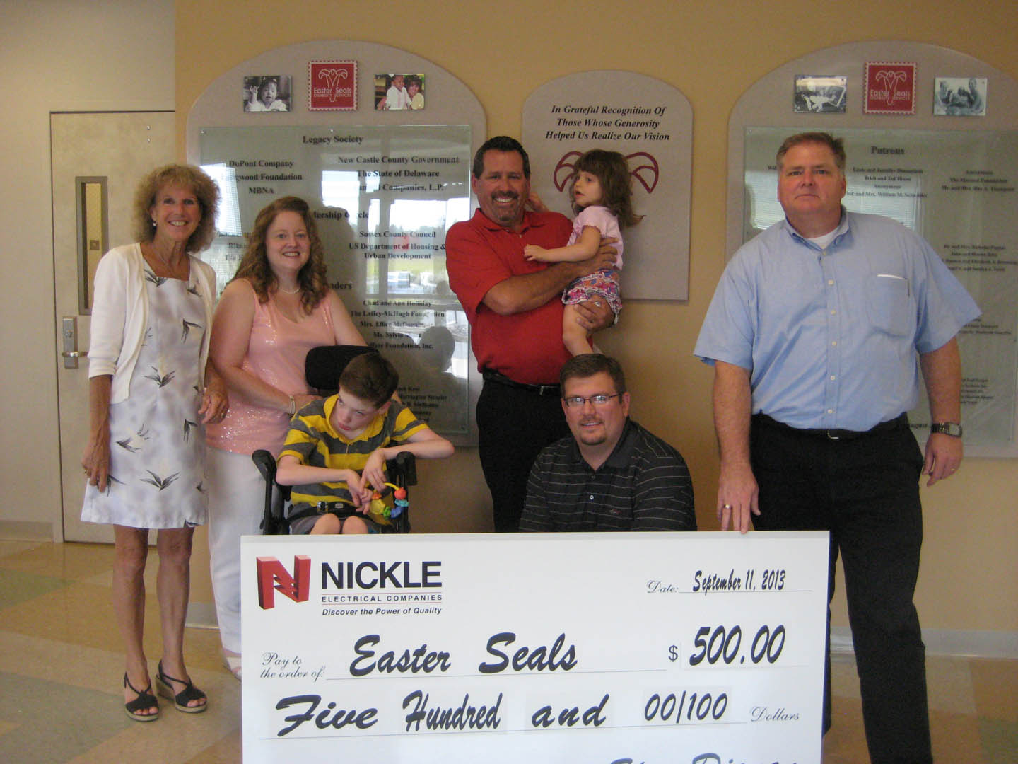 Nickle presents check to Easter Seals